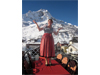 In traditional Austrian dress, a Austrian hotel manager 