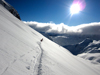 Skiers break fresh tracks high in the Austrian Alps above Zurs, headed to famed backcountry skiing.  The Arlberg region is noted for it's off piste and back country skiing