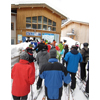 Skiers wait in the lift line at the Zug 