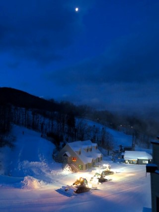 Snow Groomers working under moon over Loon Mountain