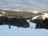 Skiers descending from summit of Loon Mountain in New Hampshires White Mountains