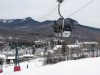 Loon Mt. Gondola near base with Loon Mountain Club ski in / ski out Hotel & resort background