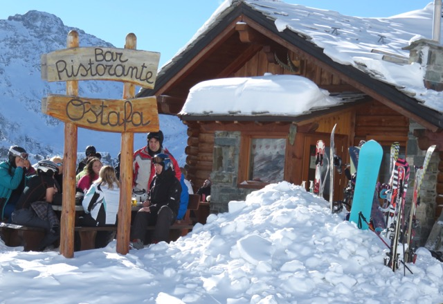 Skiers enjoy a mountain hut in the Monte Rosa during a ski break.