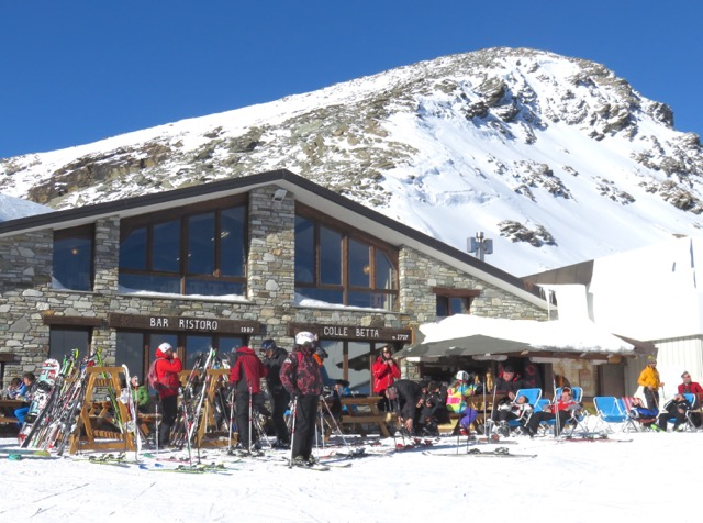 Skiers outside the modern mountain hut Colle Betta above Gressoney  Colle Betta serves skiers and tourists traditional mountain dishes.