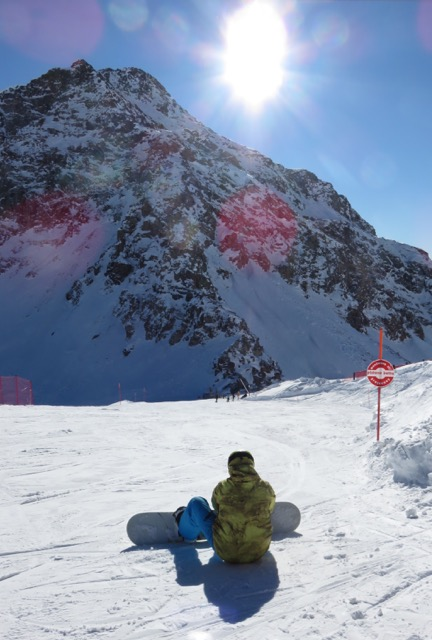 A snow-boarder prepares to ride in the Monte Rosa