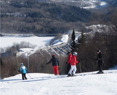 Skiers enjoy the day at Mont-St-Anne