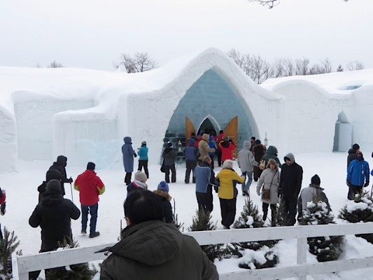 Entrance of Ice Hotel as tourists arrive to enjoy day in unique setting