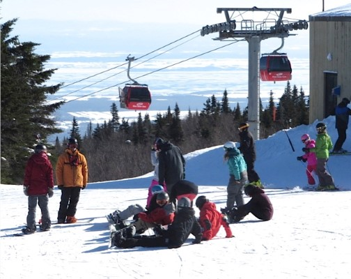 Skiers and riders at Mont-St- Anne Ski Resort summit