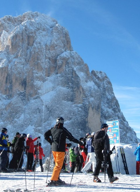 Skiers enjoy the beauty of the massif Dolomite's on the Sella Ronda tour.