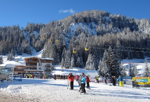 Skiers in the mountain town of Corvara, high in the Italian Dolomites