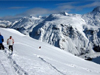 Skiers descend in fresh powder in the Arlberg region of Austria