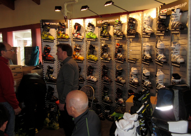 Ski industry reps talk with ski retailers on new ski boots for the next ski season.
