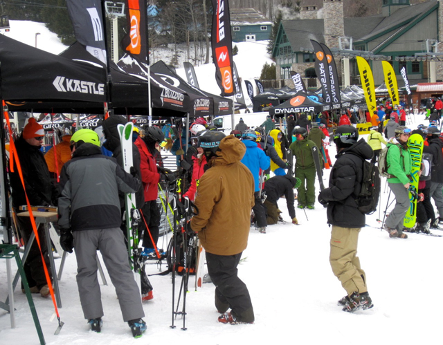 In a festive setting of booths and ski company banners flying at Stratton Mt., ski retailers talk with ski company reps on new products and ski product selection for on snow testing.