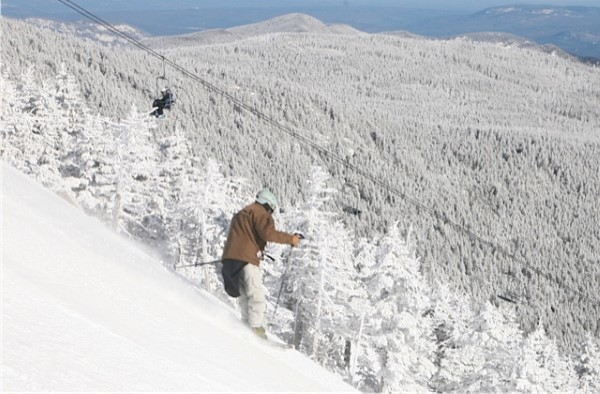 A skier descends on the Mens Downhill course from summit of Whiteface Mt.