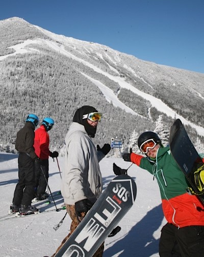 Skiers and Riders atop Little Whiteface enjoy views of the summit of Whiteface Mt.