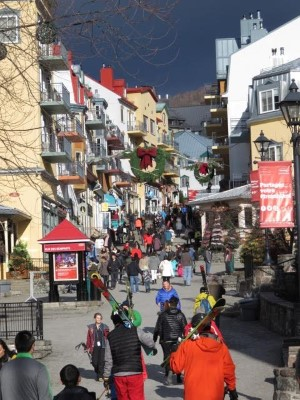 Skiers and visitors pass through the Tremblant Village, some for skiing others for shopping. Tremblant receives of 2 million visitors a year at the 4 season resort in Quebec