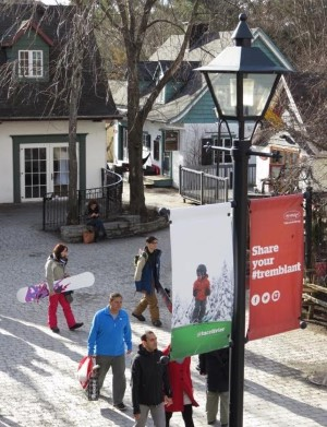 Tourists and Winter enthusiast walk past some of the restored old Tremblant cottages in Tremblant Village