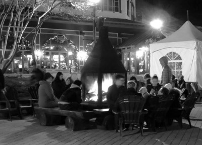 A wood burning fire in the Plaza Square brings visitors to a relaxed evening setting