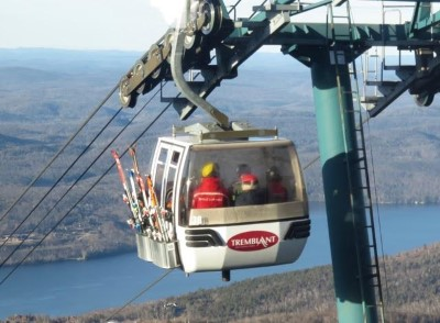 A Tremblant Gondola nears the summit with Lac Tremblant in the background