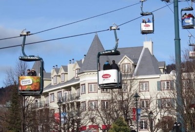 Tourists and Visitors ride the open Gondola to the Tremblant Village plaza
