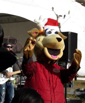 The Tremblant mascot interacts with visitors in the Village Square