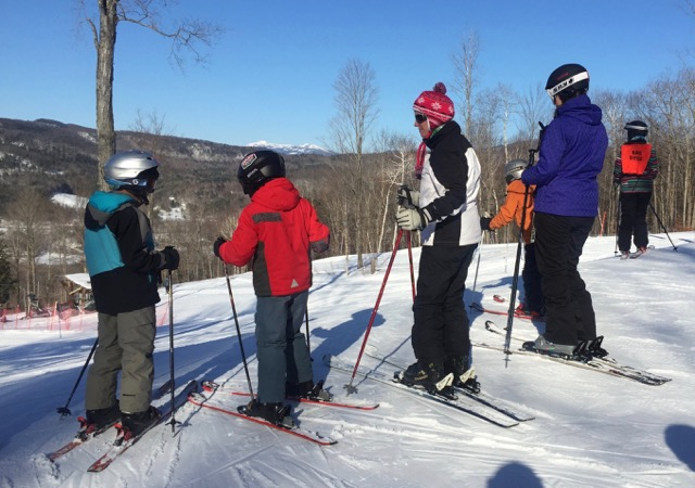 A skiing family enjoys a day at Cochran Ski Area in northern Vermont
