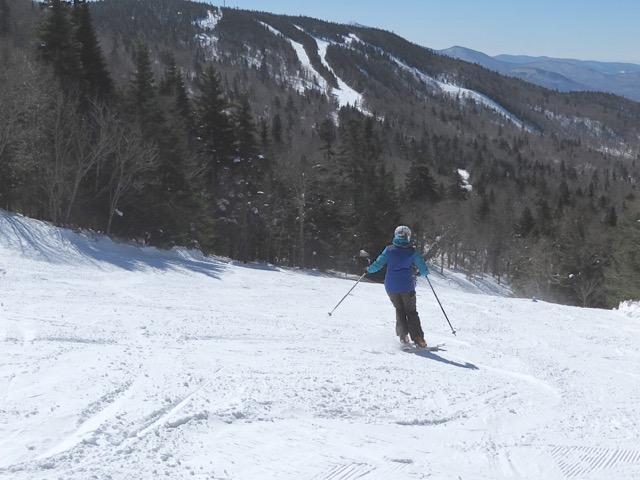 A skier carves turns on the freshly groomed trails at Bolton Valley